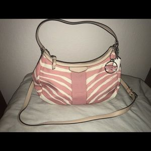 Coach pink and tan hand bag.